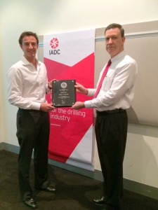 IADC's Mike DuBose presents Julian Soles of Transocean the 2013 Offshore Award.