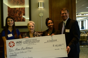 IADC Houston Chapter members present a check to Home Run Hitters International  Left to Right: Allison Fraser, Rowan; Marcy Sandell; Dr. Deborah Carr, TITLE at Home Run Hitters and Scott Gordon, Derrick Equipment.