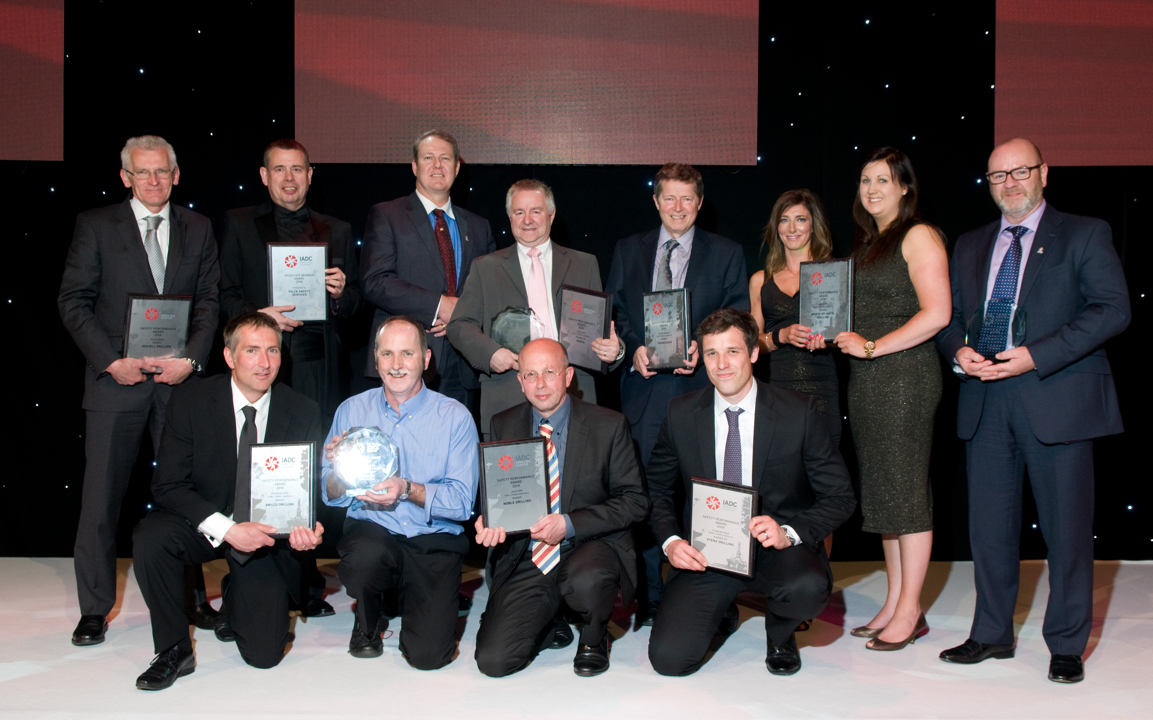 IADC safety awards winners and runners-up 2015, Left to right: BACK ROW: Eddie Fowler, Odfjell Drilling; Neil Burr, Falck Safety Services; Lee Reborse, Noble Drilling; Eric Holmes, Ensco; Adrian Blake, Transocean; Nicola Riddel and Eilidh Shaw, North Atlantic Drilling; Jim Paterson, KCA Deutag. FRONT ROW: Mike Brumfield, Awilco Drilling; Pete Thomson, on behalf of Awilco Drilling; Hans Krielen, Noble Drilling; Tony Rhodes, Stena Drilling