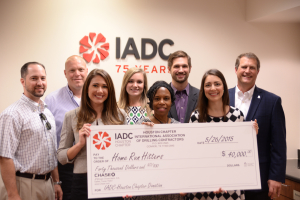 IADC Houston Chapter members present a check to Home Run Hitters International. From Left: From Left: Brian Townsend; Jeff Kessler, Chapter Chairman; Christine Thorp, Par Petroleum Corporation; Leslie Packard, IADC; Dr. Deborah Carr, Home Run Hitters; Andrew Gordon, Cameron; Allison Fraser and Scott Gordon, Helmerich & Payne.