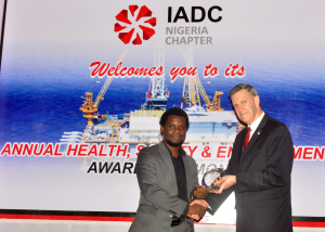 Mike DuBose, IADC Vice President, International Division presents Mr. Tunji Adenuga of Indigo Drilling with the award for best improved company during the IADC Nigeria Chapter's safety awards event.