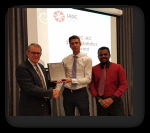 Mark Denkowski, IADC Executive Vice President, Operational Integrity presents the offshore safety award plaque to Sebastian Van Diemen, Noblecorp Drilling Superintendent and Yoga Rajan, Noblecorp Regional HSE Supervisor.