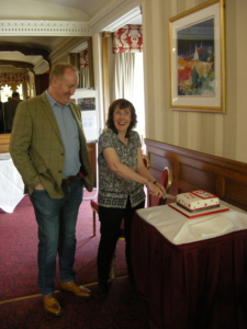 Edith McLeod, current NSC Administrator and Pete Wilson, current NSC Chairman, cut the 45th anniversary cake during the 18 May gathering of current and former IADC North Sea Chapter members.
