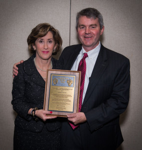 Julie Robertson of Noble Corp accepts the 2013 IADC Contractor of the Year award from Clay Williams with award sponsor NOV at the 2013 IADC Annual General Meeting in San Antonio, Texas.